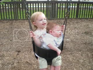 Sister and brother on the swing
